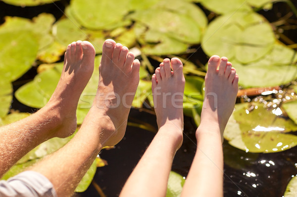 grandfather and grandson feet over river Stock photo © dolgachov