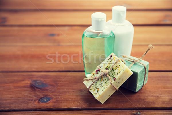 close up of handmade soap bars and lotions on wood Stock photo © dolgachov