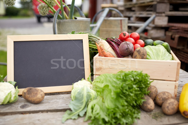 close up of vegetables with chalkboard on farm Stock photo © dolgachov
