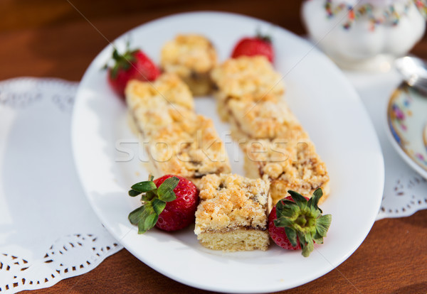 pieces of cake or pie and strawberries on plate Stock photo © dolgachov