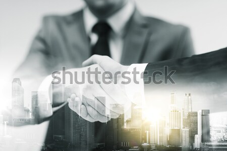 close up of businessman hand holding casino dice Stock photo © dolgachov