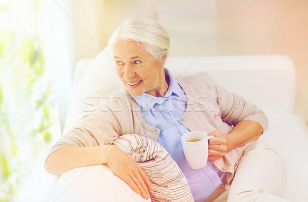Feliz senior mulher copo chá casa Foto stock © dolgachov
