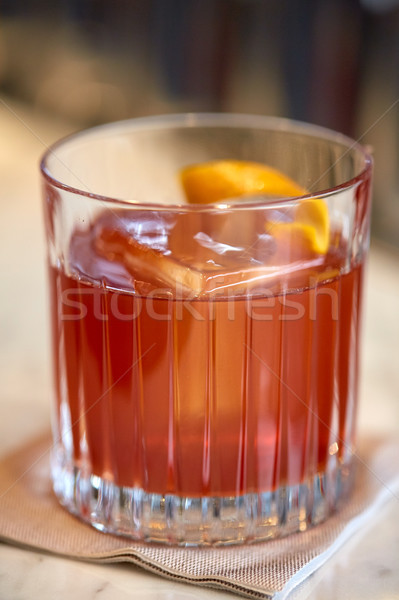 close up of glass with orange cocktail at bar Stock photo © dolgachov