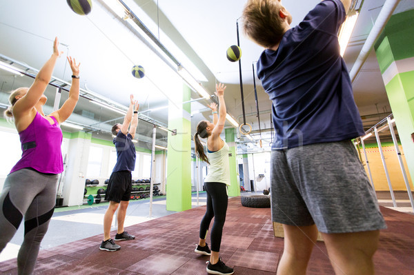 group of people with medicine ball training in gym Stock photo © dolgachov
