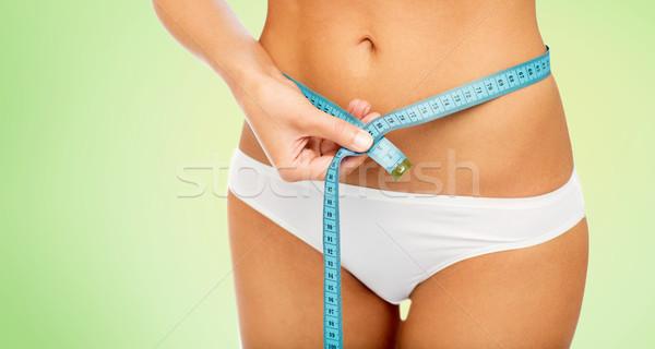 Mulher corpo fita métrica cintura dieta Foto stock © dolgachov