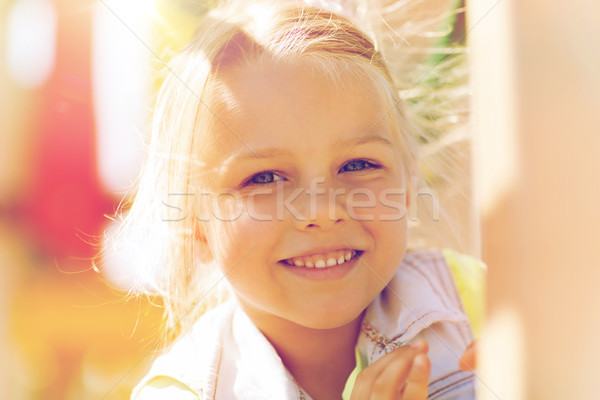 Boldog kislány mászik gyerekek játszótér nyár Stock fotó © dolgachov