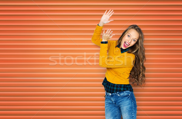 happy young woman or teen girl applauding Stock photo © dolgachov