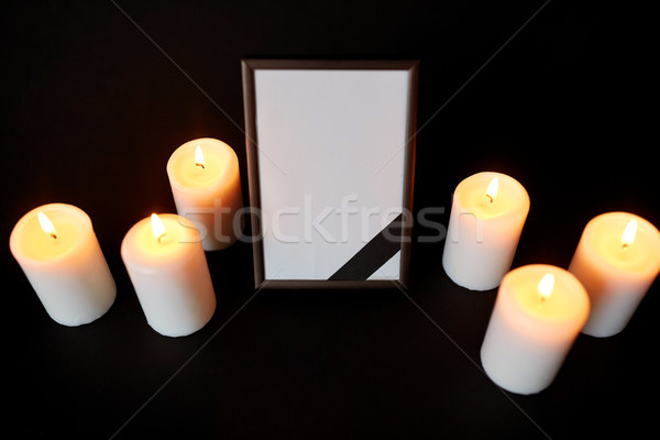 photo frame with black mourning ribbon and candles Stock photo © dolgachov