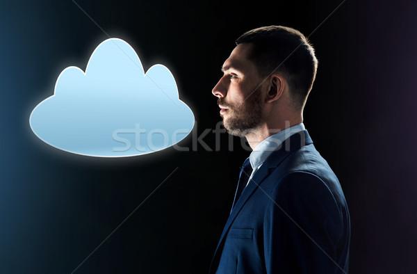 businessman in suit looking at cloud projection Stock photo © dolgachov