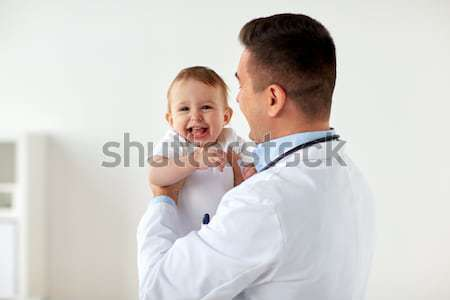 Gelukkig arts kinderarts baby kliniek geneeskunde Stockfoto © dolgachov