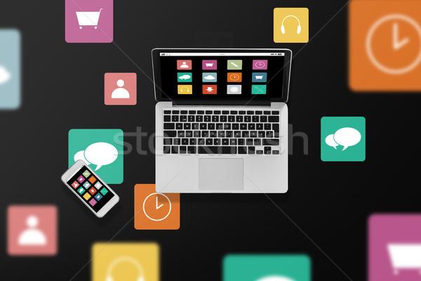 Laptop menu ikona smartphone multimedialnych technologii Zdjęcia stock © dolgachov