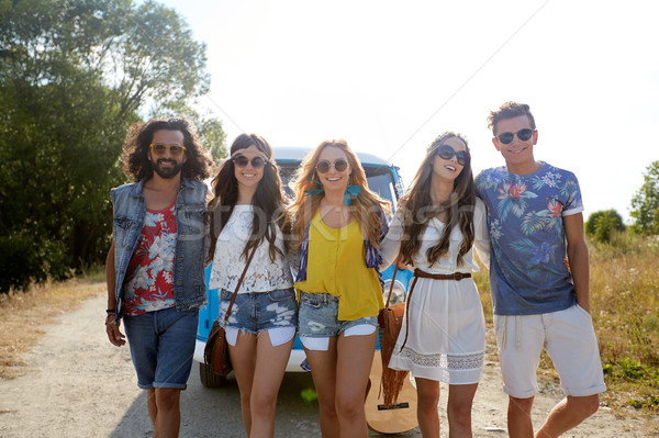 smiling happy young hippie friends and minivan car Stock photo © dolgachov