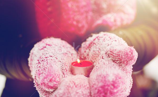 Mani inverno muffole candela Foto d'archivio © dolgachov