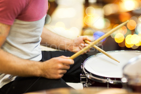 close up of musician or drummer playing drum kit Stock photo © dolgachov
