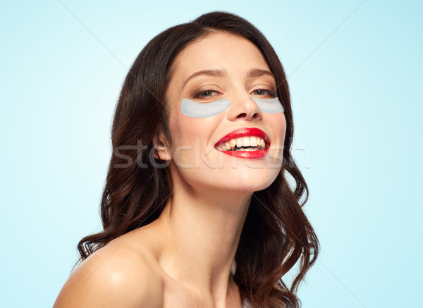 beautiful young woman with hydrogel eye patches Stock photo © dolgachov