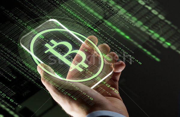 close up of hands with smartphone and bitcoin Stock photo © dolgachov