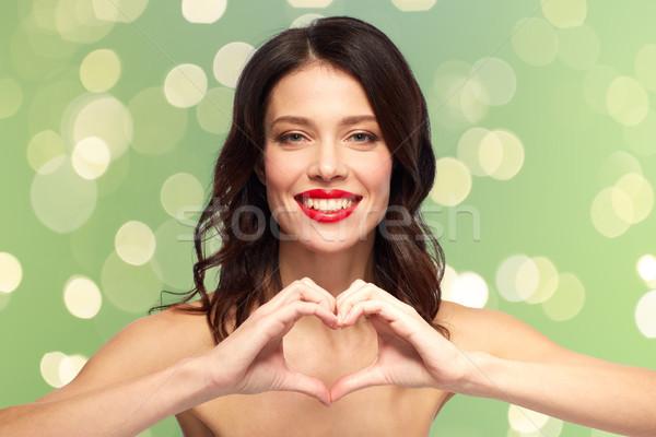 Güzel bir kadın kırmızı ruj el kalp sevgililer günü güzellik Stok fotoğraf © dolgachov