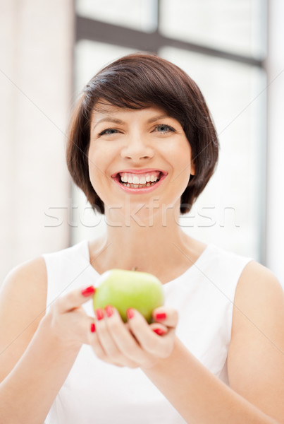 lovely housewife with green apple Stock photo © dolgachov