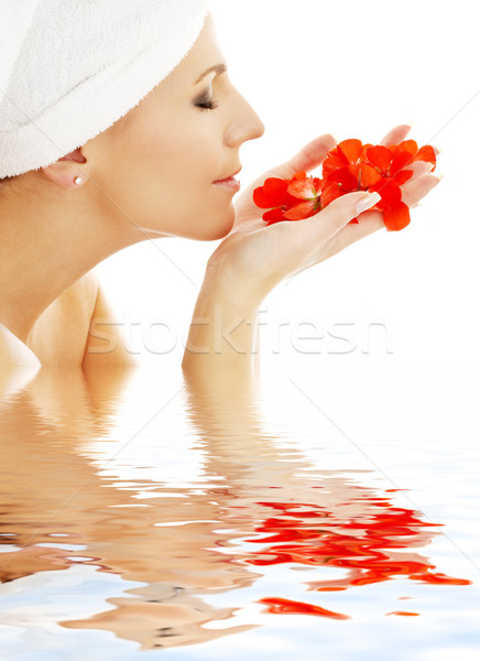 red petals in water #2 Stock photo © dolgachov