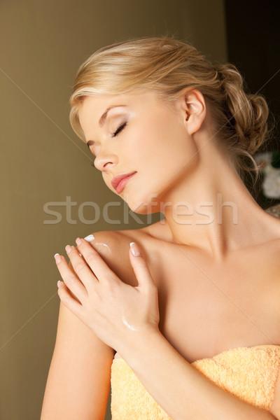 woman applying skin creme Stock photo © dolgachov