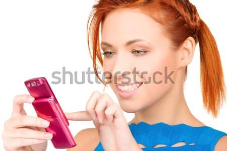 Gelukkig vrouw mobiele telefoon foto business meisje Stockfoto © dolgachov