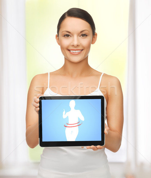 woman holding tablet pc with dieting application Stock photo © dolgachov