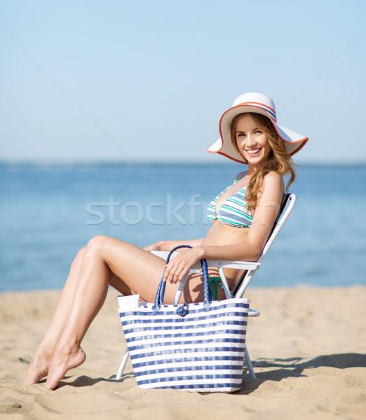 girl sunbathing on the beach chair Stock photo © dolgachov