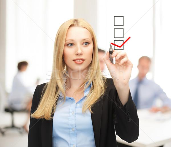 businesswoman drawing checkmark on virtual screen Stock photo © dolgachov