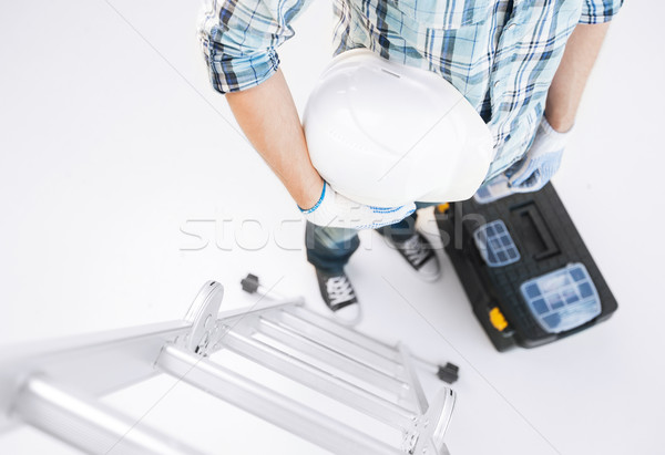man with ladder, helmet and toolkit Stock photo © dolgachov