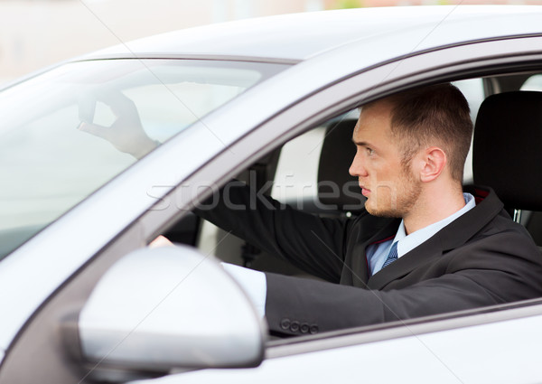 businessman driving a car Stock photo © dolgachov