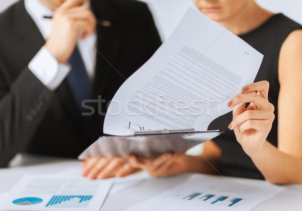 Stock photo: man and woman signing contract paper