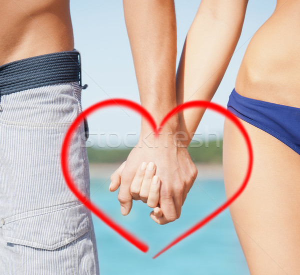 man and woman holding hands Stock photo © dolgachov