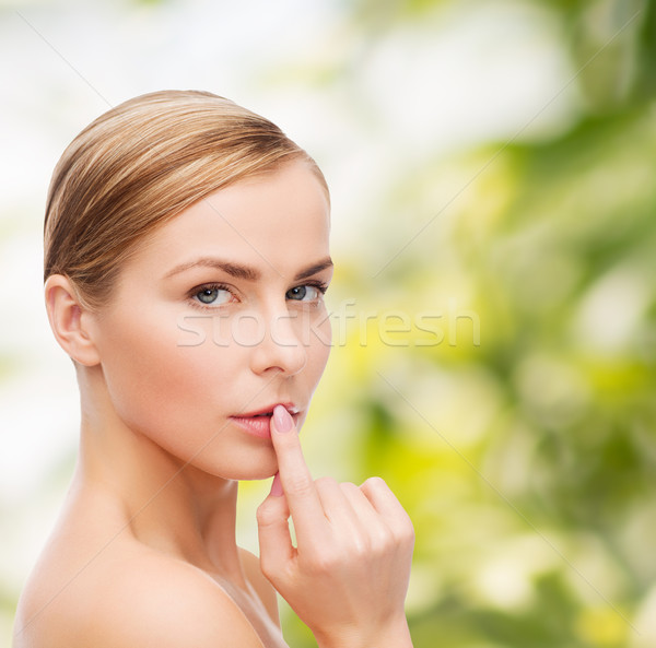 young woman doing hush gesrute Stock photo © dolgachov