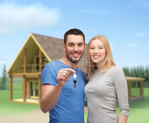 Sonriendo Pareja claves inmobiliario familia Foto stock © dolgachov
