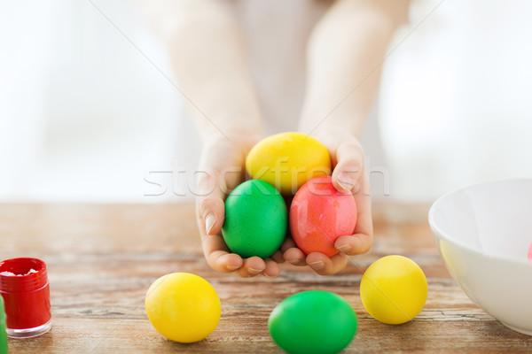 close up of girl holding colored eggs Stock photo © dolgachov