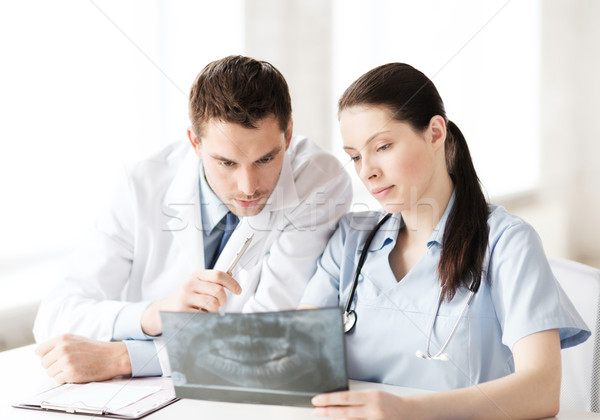 two doctors looking at x-ray Stock photo © dolgachov