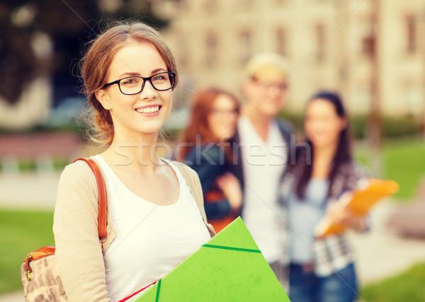 Női diák mappák nyár ünnepek oktatás Stock fotó © dolgachov