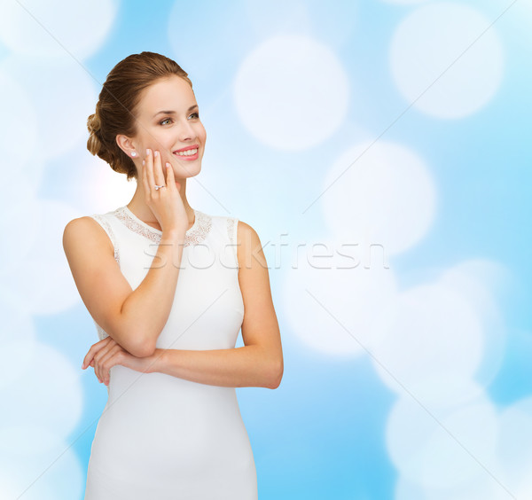Stock photo: smiling woman in white dress wearing diamond ring