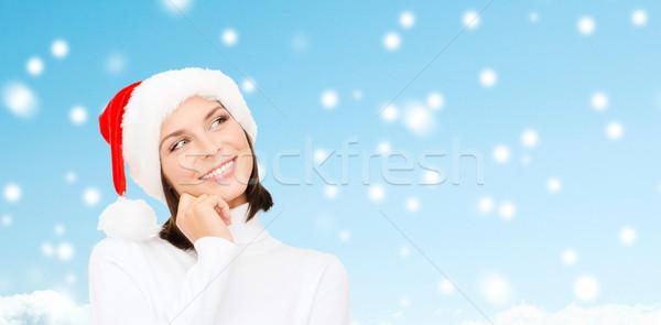 Gondolkodik mosolygó nő mikulás segítő kalap karácsony Stock fotó © dolgachov