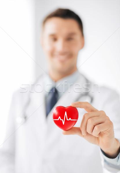Férfi orvos tart piros szív ekg vonal Stock fotó © dolgachov