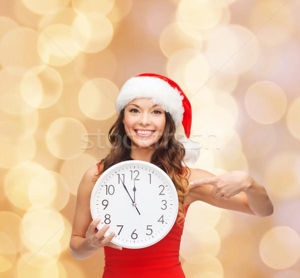笑顔の女性 サンタクロース ヘルパー 帽子 クロック クリスマス ストックフォト © dolgachov
