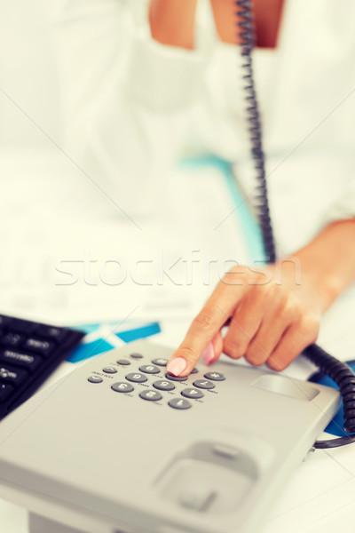 businesswoman with phone calling Stock photo © dolgachov