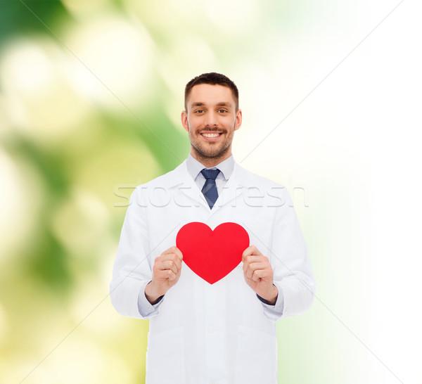 Uśmiechnięty mężczyzna lekarz czerwony serca muzyka zawód Zdjęcia stock © dolgachov