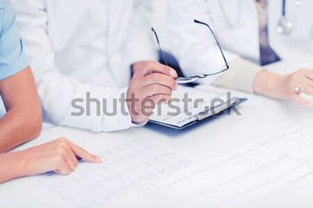 Empresario gafas escrito cuaderno negocios oficina Foto stock © dolgachov