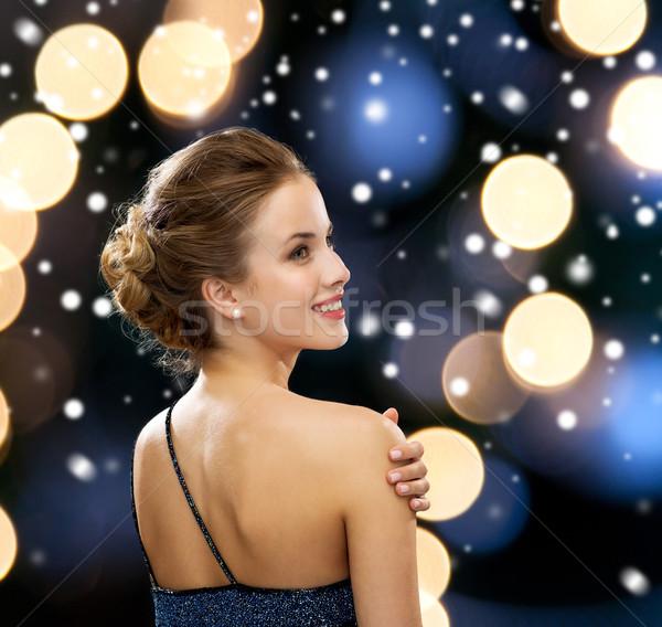 улыбающаяся женщина вечернее платье люди праздников Рождества гламур Сток-фото © dolgachov