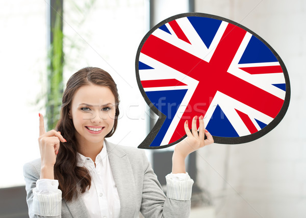 smiling woman with text bubble of british flag Stock photo © dolgachov