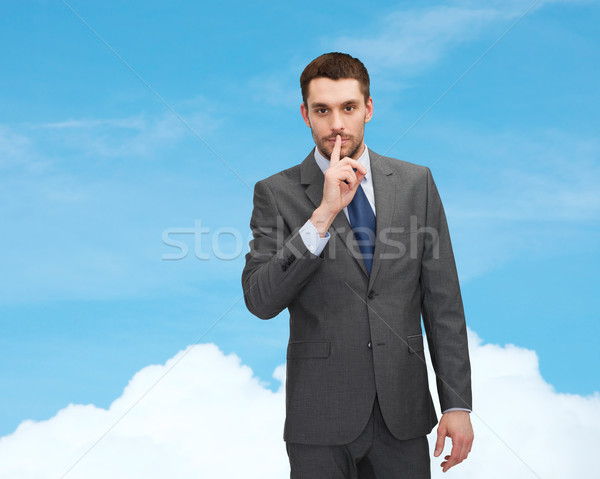 young businessman making hush sign Stock photo © dolgachov