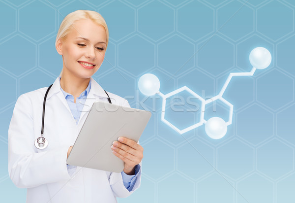 smiling female doctor with tablet pc and molecule Stock photo © dolgachov