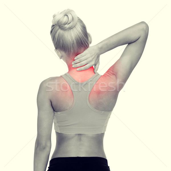 женщину прикасаться шее фитнес здравоохранения Сток-фото © dolgachov