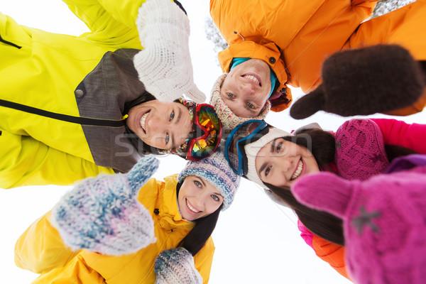 Feliz amigos invierno ropa aire libre ocio Foto stock © dolgachov